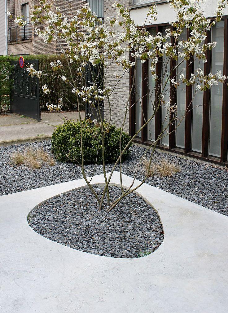 Concrete and gravel pattern- gravel garden to surround deck/tiki area.  Modern and easy to do