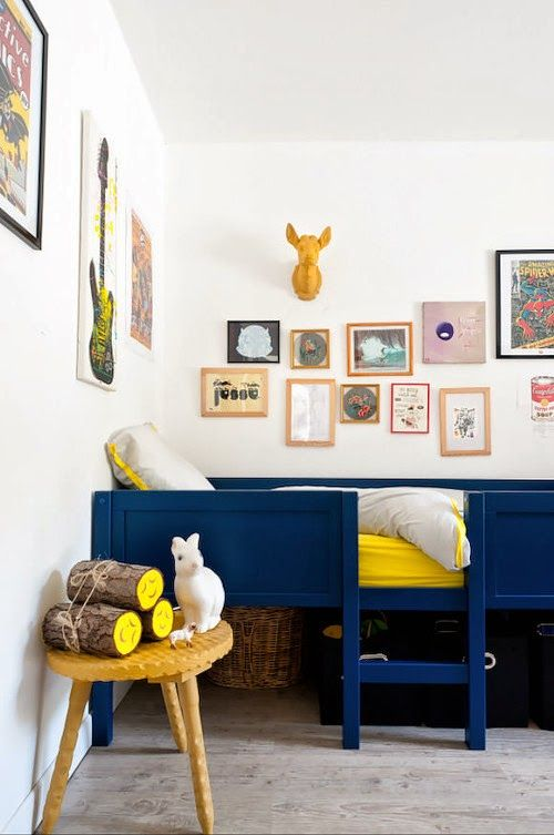 Love the dark blue furniture with mustard yellow and pops of color.