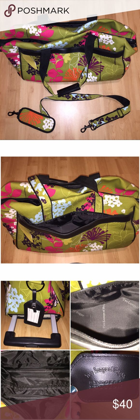⬇️PRICE DROP⬇️BNWOT Two Lumps Of Sugar Travel Bag BNWOT Two Lumps of Sugar Rolling Travel Bag comes BRAND NEW without tag. Beautiful floral print is perfect for the trendy traveler! Can be rolled, carried by the short handle or cross body with the long handle! My prices fluctuate from time to time. Catch items when the prices are low!❤️ Two Lumps of Sugar Bags Travel Bags