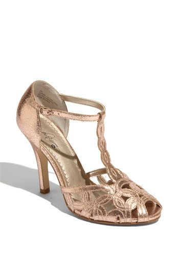 Rose gold heels.  And they look like they might be fairly comfortable for dressy straps.