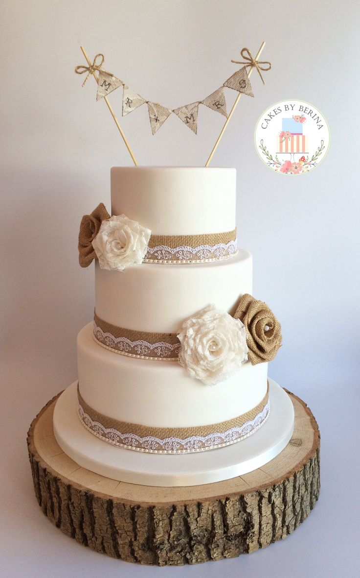 Rustic vintage wedding cake with hand made lace and hessian roses www.facebook.com/cakesbyberina