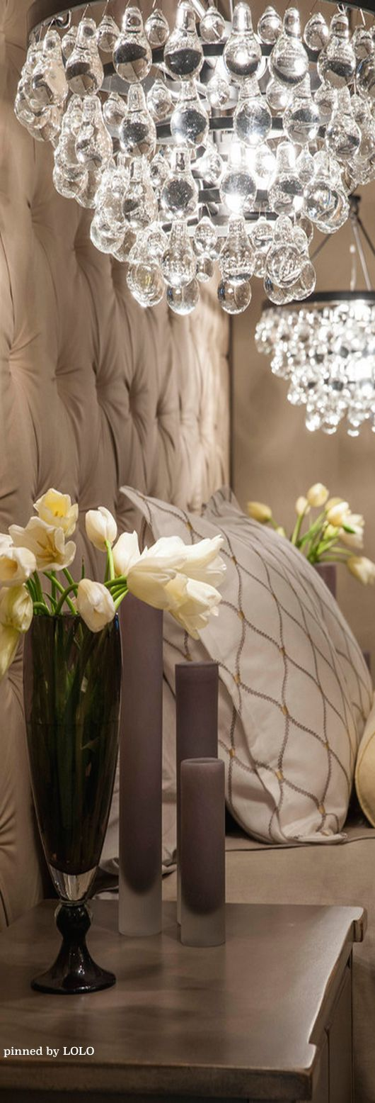 I have tulips in a tall waterford vase on my nightstand like this.... My headboard (like this one) is deep dark leather brown Love the bedding!