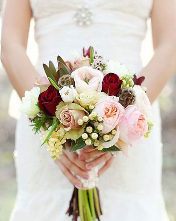 pink , white , red wedding boquet I like the use of only some dark flowers