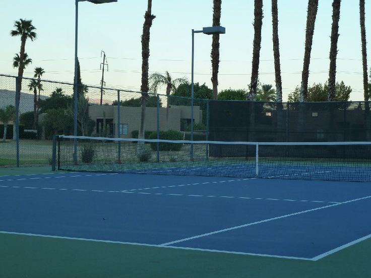 The evening when it cools off is a great time to play tennis in Palm Springs during the hot months.