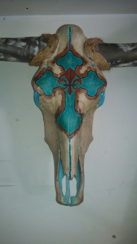 Painted cross cow skull