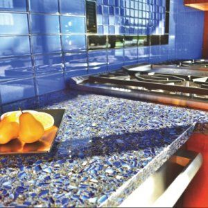 Recycled glass countertops are made from post-commercial and industrial recycled glass. Manufacturers like Vetrazzo offer many color options for clients. Vetrazzo's sky blue countertops (pictured) are made with recycled Sky Vodka bottles. (Photo by Vetrazzo)