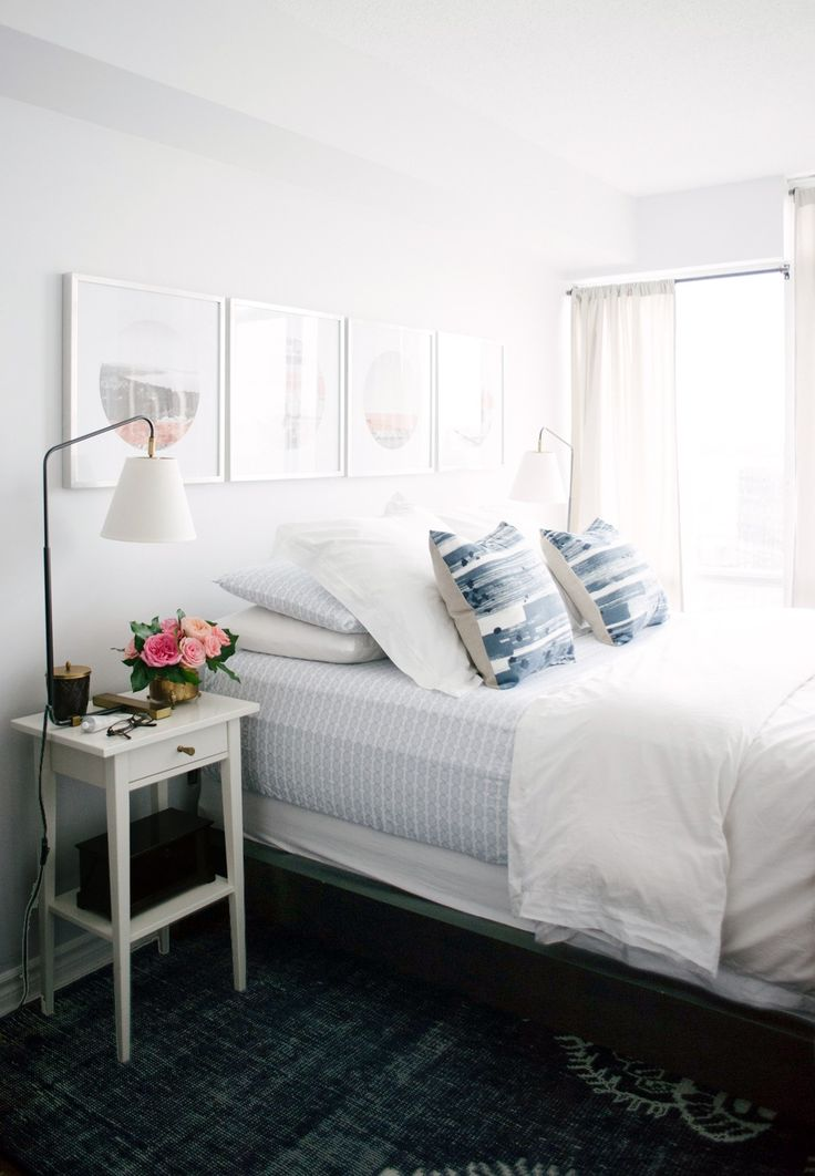 Serene bedroom with great linens + artwork