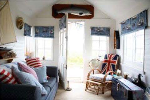 Interiors beaches and beach huts on pinterest for Beach hut interiors