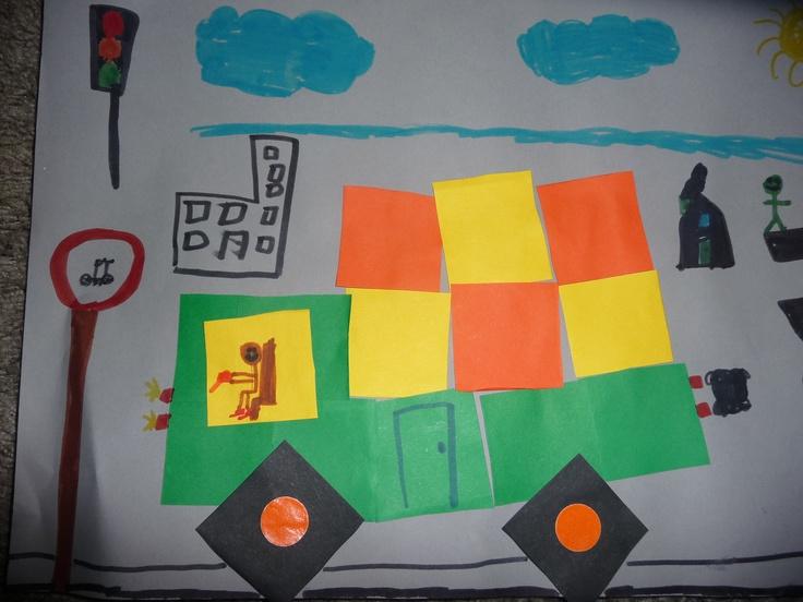 MAP: de kinderen maken eerst de vrachtwagen van blokjes en tekenen op de achtergrond de weg, verkeerslichten, verkeersborden enz.