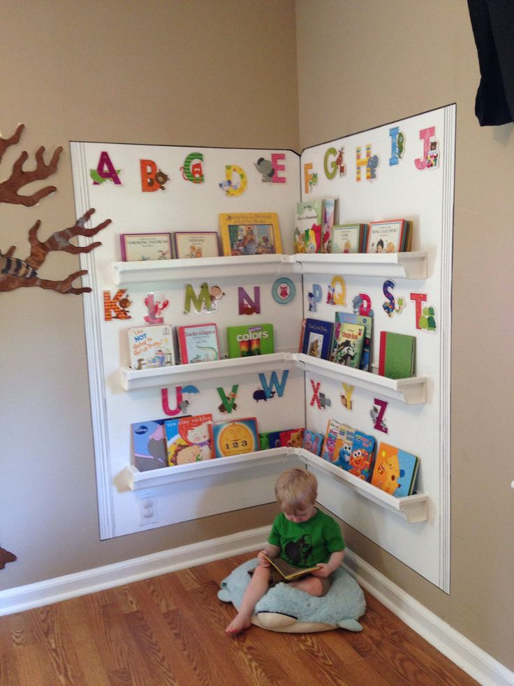 My husband and I made this cozy reading corner for my in-home Childcare. Made with rain gutters. #homedaycarebusiness