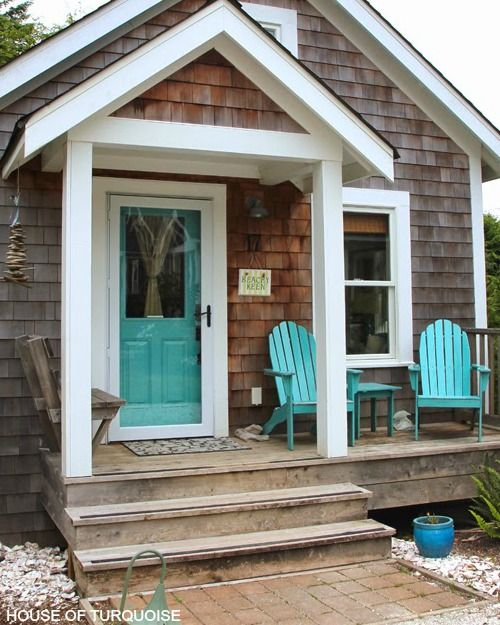 A Beachy Keen entry to a cottage with turquoise front door, turquoise Adirondack chairs... and a Beach Keen Sign. Featured on Front Door Ideas: http://www.completely-coastal.com/2016/05/coastal-nautical-front-door-ideas.html