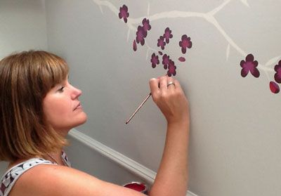 Painting pretty blossom in a girl's bedrooms - The Creative Decorator - Mural Painting