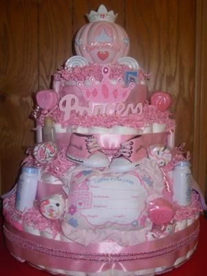 Princess Theme Diaper Cake: This is a 4 Tier Princess Themed Diaper Cake.    It was baked using 200 disposable diapers, 1 Keepsake Pillow, 1 Pair of Baby Booties, 3 Johnson & Johnson