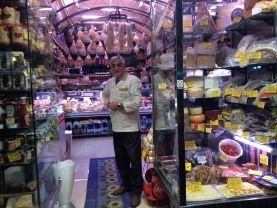 Mr. Genovese in his deli shop in via Cimarosa, Naples Italy