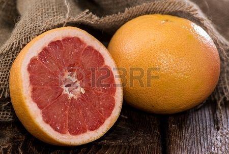 http://www.123rf.com/photo_18952951_fresh-grapefruit-on-wooden-background.html