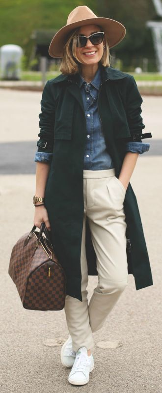 Trench coat style + completely adaptable + whole host of different looks + Priscila Betancort + navy trench + super cool androgynous style + denim button up + classic chinos   Brands not specified.