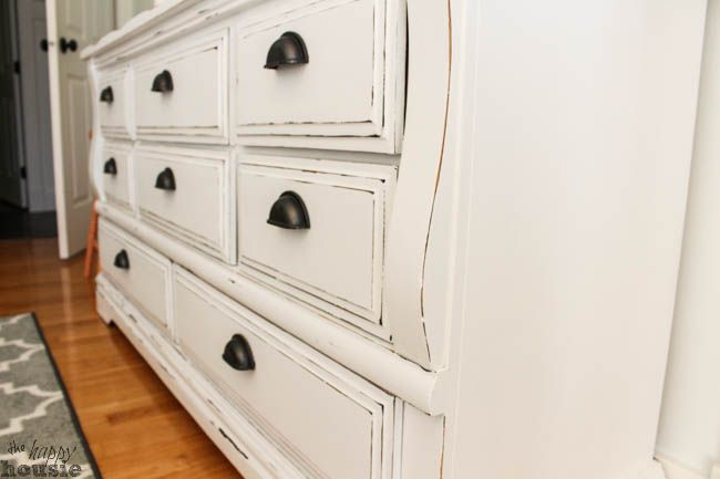 White Distressed Chalky Paint Dresser Makeover at The Happy Housie-14 I like this look to redo my old changing table / dresser.
