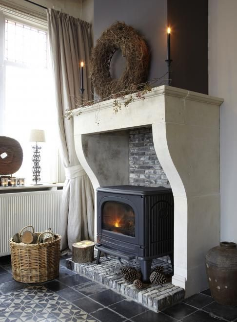 Love the stone mantle fireplace around this wood burner and the tiled floor.