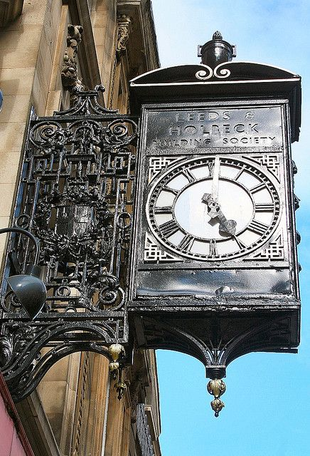 Elaborate timepiece in Broad Street, Bristol. The faded lettering says Leeds and Holbeck Building Society.