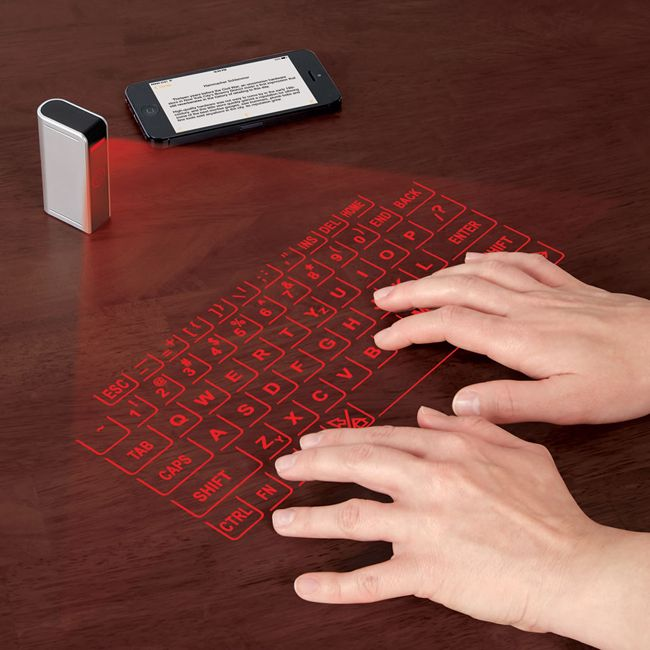 The Laser Projection Keyboard is one incredibly cool & futuristic gadget that serves a great purpose. Bluetooth to your mobile or tablet, and type away!