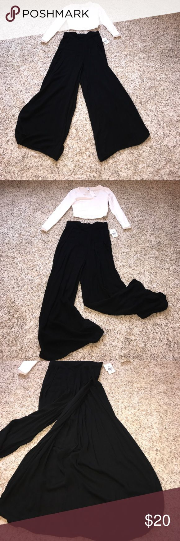 NWT Side Slit Palazzo Pants These Black side slit palazzo pants have a banded waist with rubber in the back. These pants can be dressed down and dressed up. If you're looking for a more casual look these pants pair well with a crop top, a cross body bag, and sandals or sneakers. If you want to dress it up even more, this would look nice with a sequin top and a pair of dressy heels. living doll Pants Wide Leg