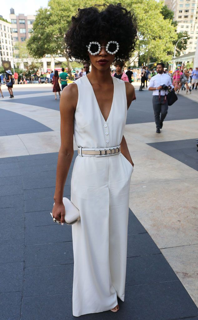 Carlitta from New York Fashion Week Spring 2015 Street Style  Disco girl! Carlitta's 70's-inspired white jumpsuit and pearly shades are the perfect throwback to the groovy era.