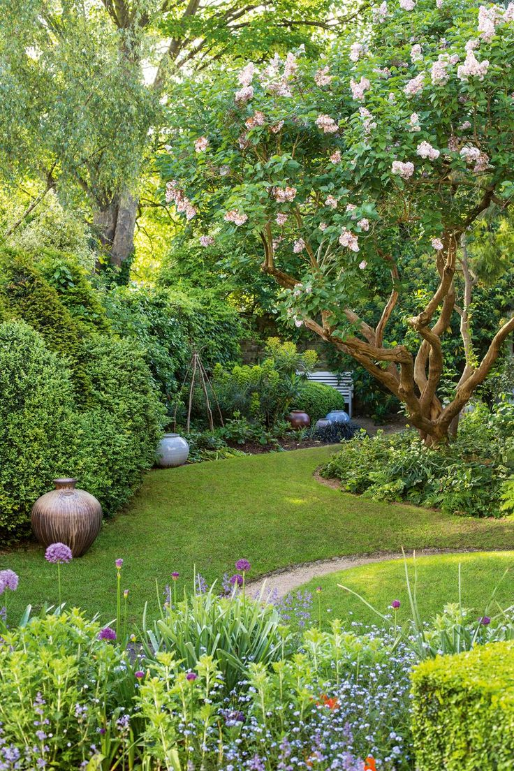 Curator and potter Joanna Bird has turned her garden into an lush exhibition space