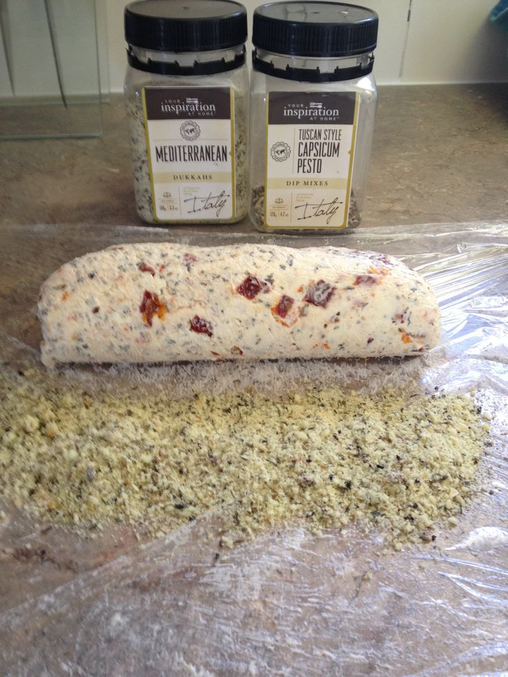 YIAH Tuscan Style Capsicum Pesto dip and sundried tomato cheese log ready to be  rolled in YIAH Mediterranean Dukkah
