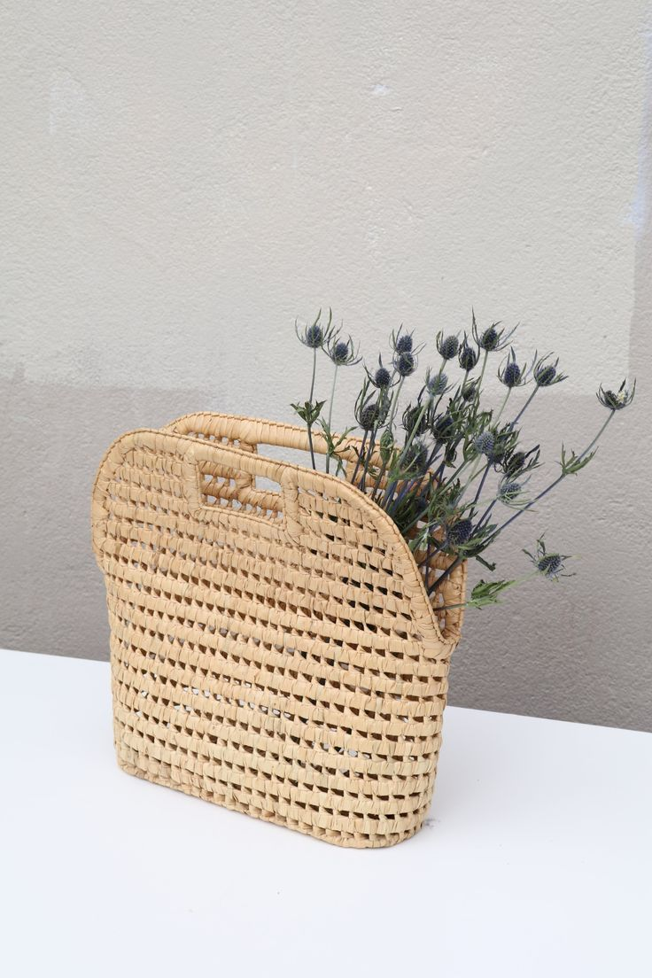 Vintage straw woven basket bag with a stiff, structural shape. Good ...