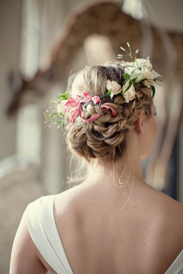 The beautiful rose garland intertwined with a braid makes for a very attractive wedding hairstyle indeed!