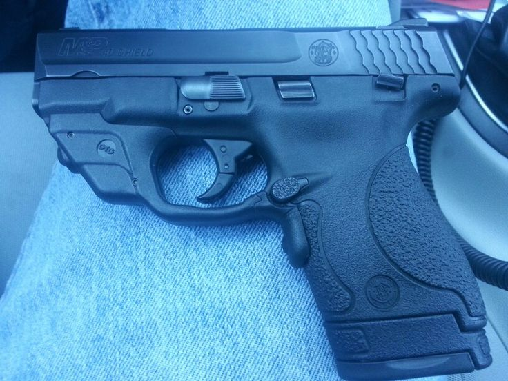 S&W M&P .40 Shield with my Crimson Trace Laser installed. Find our speedloader now! http://www.amazon.com/shops/raeind