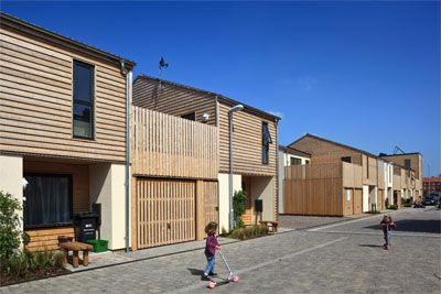 """Beautiful building concept. """"Mews"""" sort of house complex, lots of wood, very natural architectural concept."""