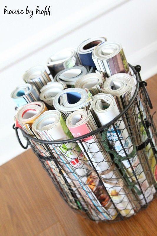 Roll up magazines, tie a ribbon or string around them, and store them in a wire basket! Love that you can see all of the pretty colors from the different covers!  House by Hoff for Just a Girl and Her Blog