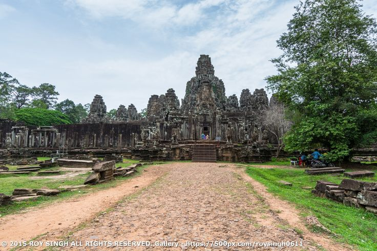The Bayon (Prasat Bayon) is a well-known and richly decorated Khmer temple at Angkor in Cambodia. Built in the late 12th or early 13th century as the official state temple of the Mahayana Buddhist King Jayavarman VII, the Bayon stands at the centre of Jayavarman's capital, Angkor Thom. Following Jayavarman's death, it was modified and augmented by later Hindu and Theravada Buddhist kings in accordance with their own religious preferences. #SiemReap #Cambodia #Temples #Bayon