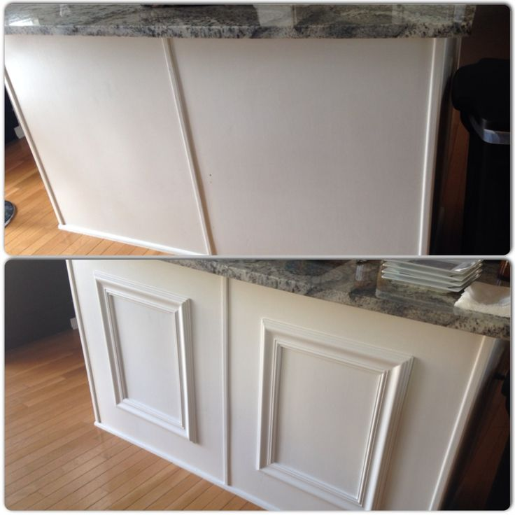 Dressing up your kitchen island with large picture frames or with pre-made wainscoting from Lowes (cheaper option).