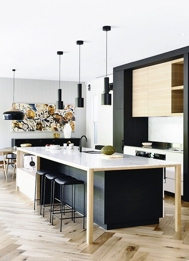 Modern kitchen with a large island, and black pendant lights