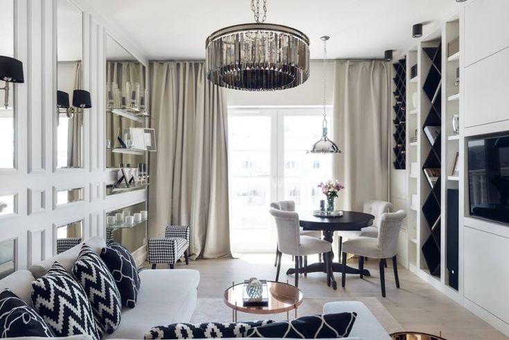Aranżacja salonu z jadalnią w nowojorskim stylu, w których dużą rolę odgrywają lustra. Połączenie bieli oraz czerni i...