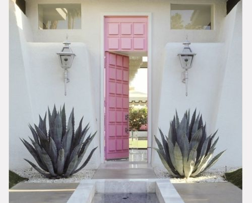 Dont like the pink color, but good idea for a long door. Palm Springs Mid Century Interiors | palm springs # pink # california # mid century modern