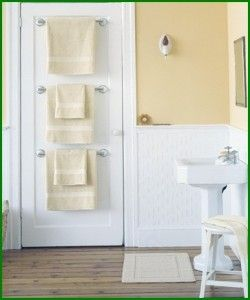 Towel racks behind bathroom door - great space saver for small bathroom. And perfect for guests. Everyone has their own towel and rack. Easy clean up!