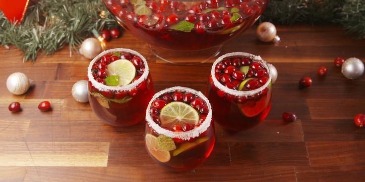 You'll be hearing jingle bells in no time. JINGLE JUICE  Cran-Apple Juice  Prosecco  Red Moscato  Vodka  Fresh Cranberries - 1 bag (freeze first)  Lime slices, fresh Mint Leaves  Rub rim w/ lime, dip in surgar