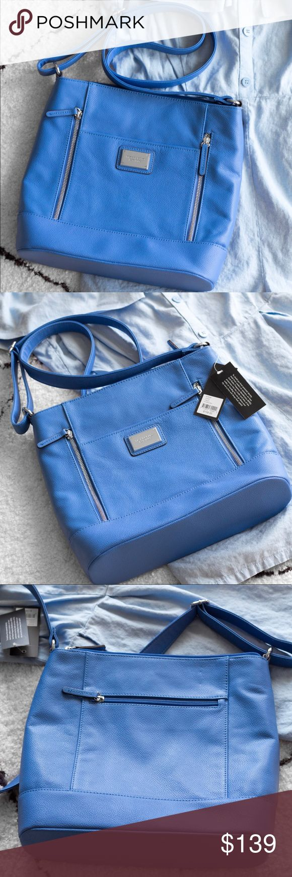 Tignanello Large Crossbody Bag BRAND NEW WITH TAGS  It has soooo many pockets. There's two separate sections inside with pockets in those too. Tignanello Bags Crossbody Bags