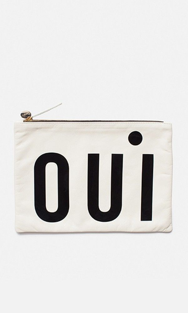 Oui, it's true! The brand has updated its signature clutch with graphic, patent lettering en francais. The smooth leather style fastens with a gold-tone coin pull and top zip.