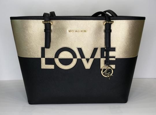 17460aa4aab6 Michael Kors Jet Set Travel Md Carryall Tote Black Gold Leather Shoulder  Bag. Get one of the hottest styles of the season! The Michael Kors Jet Set  Travel ...