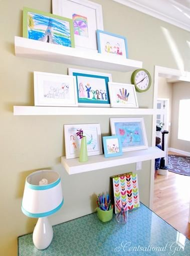 displaying kid's artwork, run some of these in the play area.