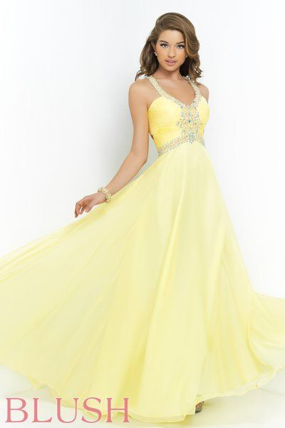 Talk about sweet and sassy! The rouged chiffon bodice and straps glitter with AB stones and clear crystals while the cut out back adds just enough drama to this phenomenal style.  Dominate the dance floor in this full circle floor length chiffon skirt. Side zipper closure. Available in Aquamarine, Crystal Pink, and Daffodil. #BlushProm #Prom2015 #BlushProm2015