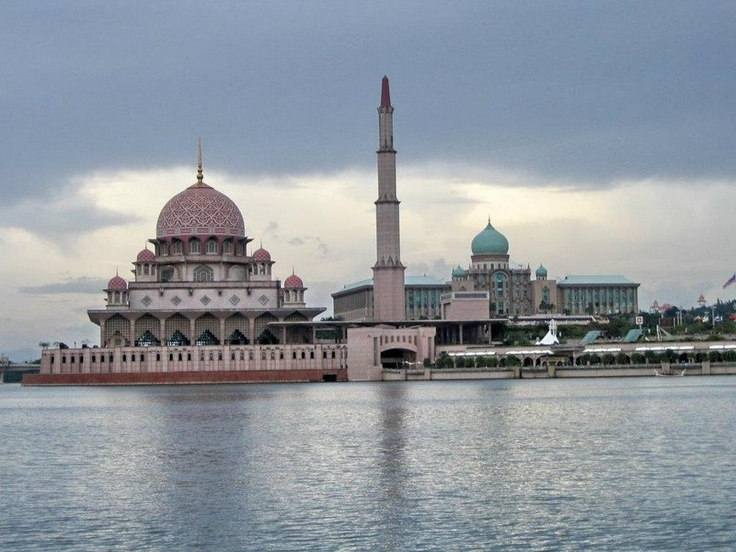 The Putra Mosque, or Masjid Putra in Malay language, is the principal mosque of Putrajaya, Malaysia. Construction of the mosque began in 1997 and was completed two years later. It is located next to Perdana Putra which houses the Malaysian Prime Minister's office and man-made Putrajaya Lake. In front of the mosque is a large square with flagpoles flying Malaysian states' flags.