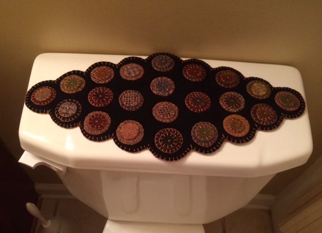 I just made 2 of these for back of toilet. Giving as a Christmas gift. Love making penny rugs.