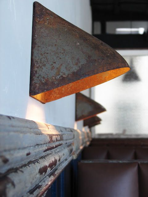 Ariele Alasko, metal wall sconces from il vecchio restaurant, her dad's place in California
