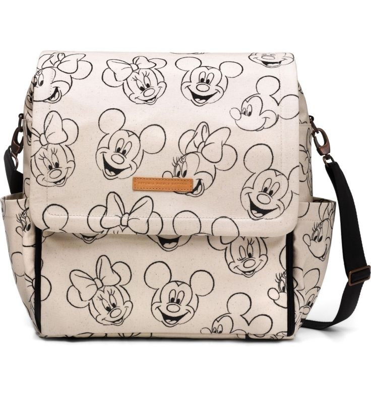 Mickey Mouse and Minnie Mouse Boxy Backpack Diaper Bag from Petunia Pickle Bottom at Nordstrom. Playful graphics of Mickey Mouse and Minnie Mouse's smiling faces delight on this classic diaper bag. The stylish bag is updated with an essential magnetic closure for soundless, easy entry so parents can access baby's belongings with one hand or while baby is sleeping. An included changing station, wipes case and plenty of pockets add ease and organization to the design.