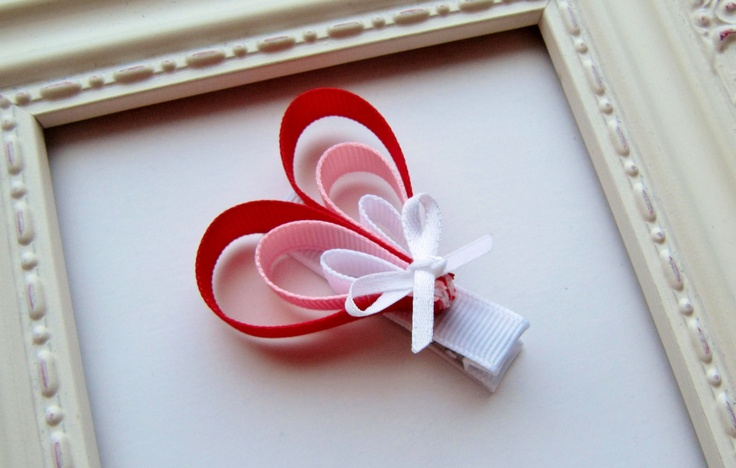 Red, Pink & White Valentine's Day Heart Ribbon Sculpture Hair Bow - Red, Pink and White - Cute Valentine Gift Idea or Party Favor. $5.00, via Etsy.